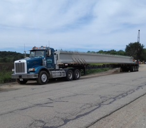 Davis job hauling 85' bridge beams  from Stress Con in Kalamazoo to the new bridge over the  Maple River in Muir, MI.